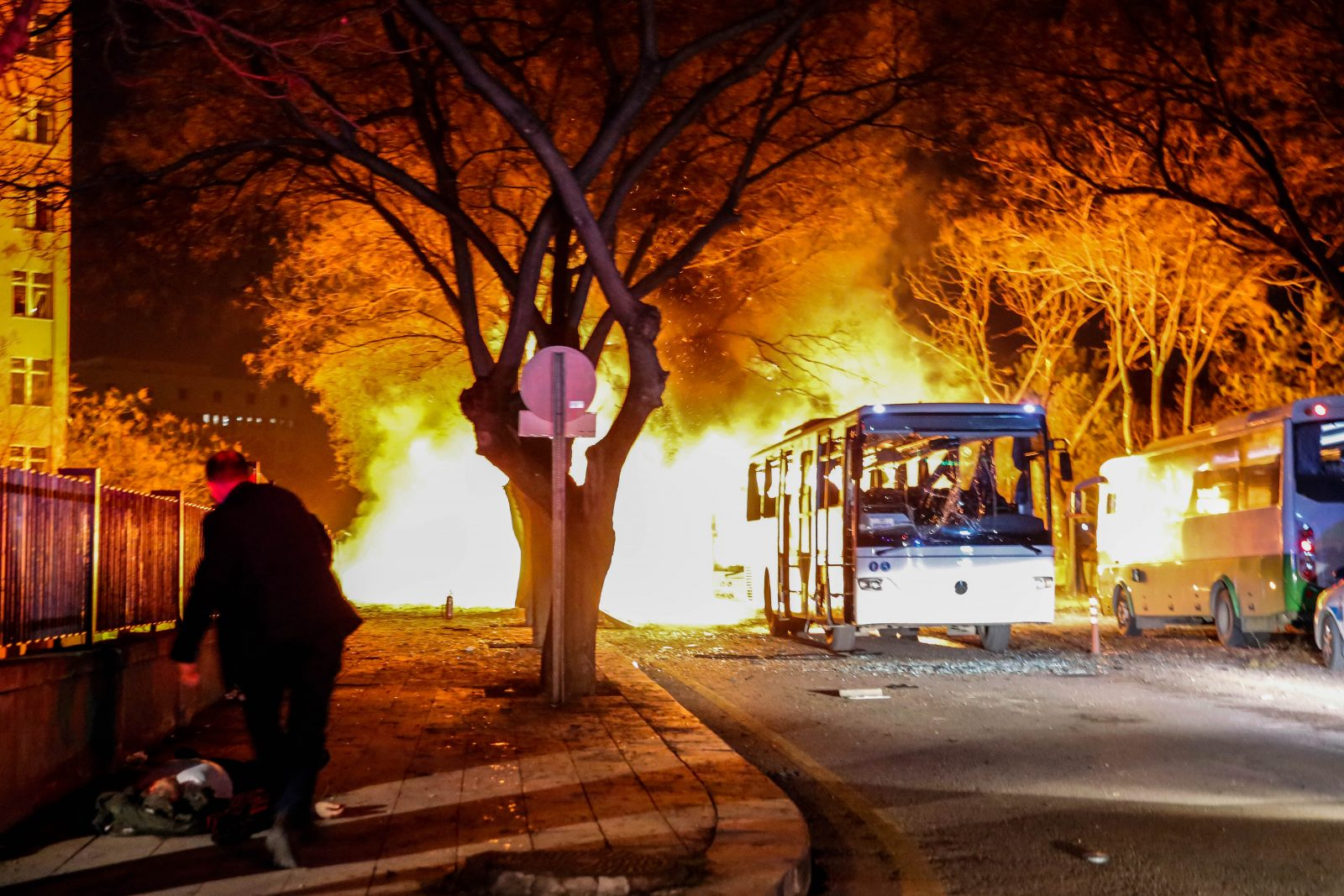 busses burning on street after explosion