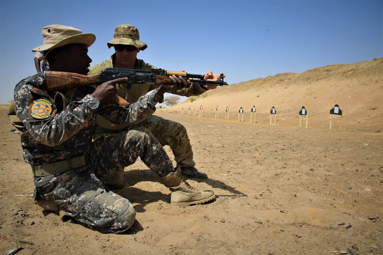 two soldiers doing marksmanship training with gun